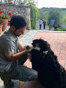 Alessio and his new friend in the organic winery in Tuscany - wine tour in Chianti - Km Zero Tours - Slow Travel Tuscany-225x300